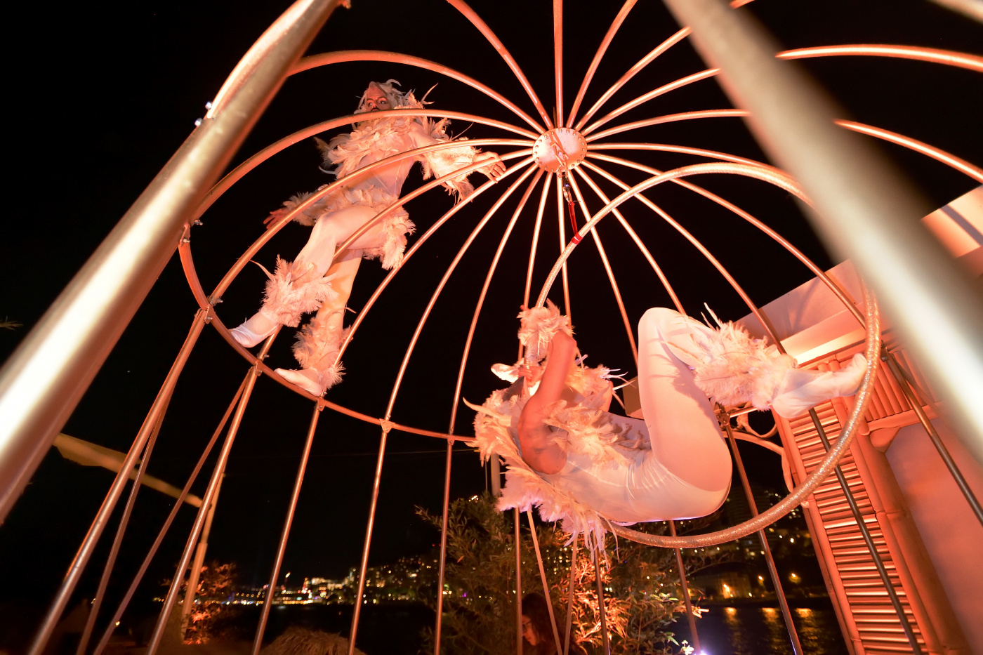 acrobats with white bird costumes as birthday party entertainment
