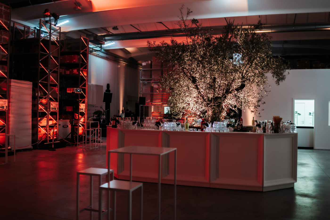 Central white bar station with big olive tree