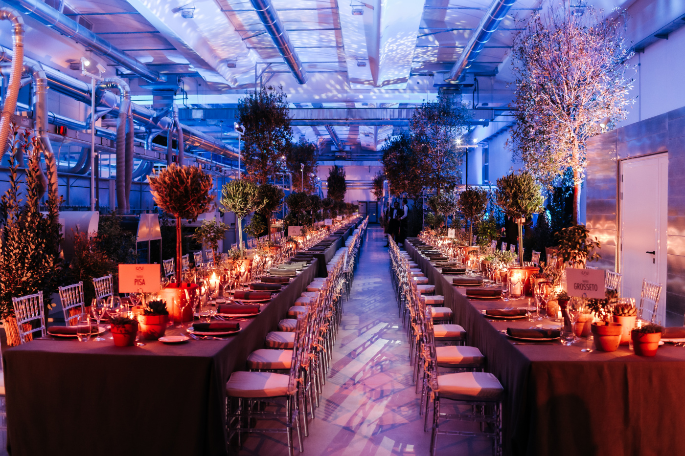 Two long rectangular tables for a corporate event dinner