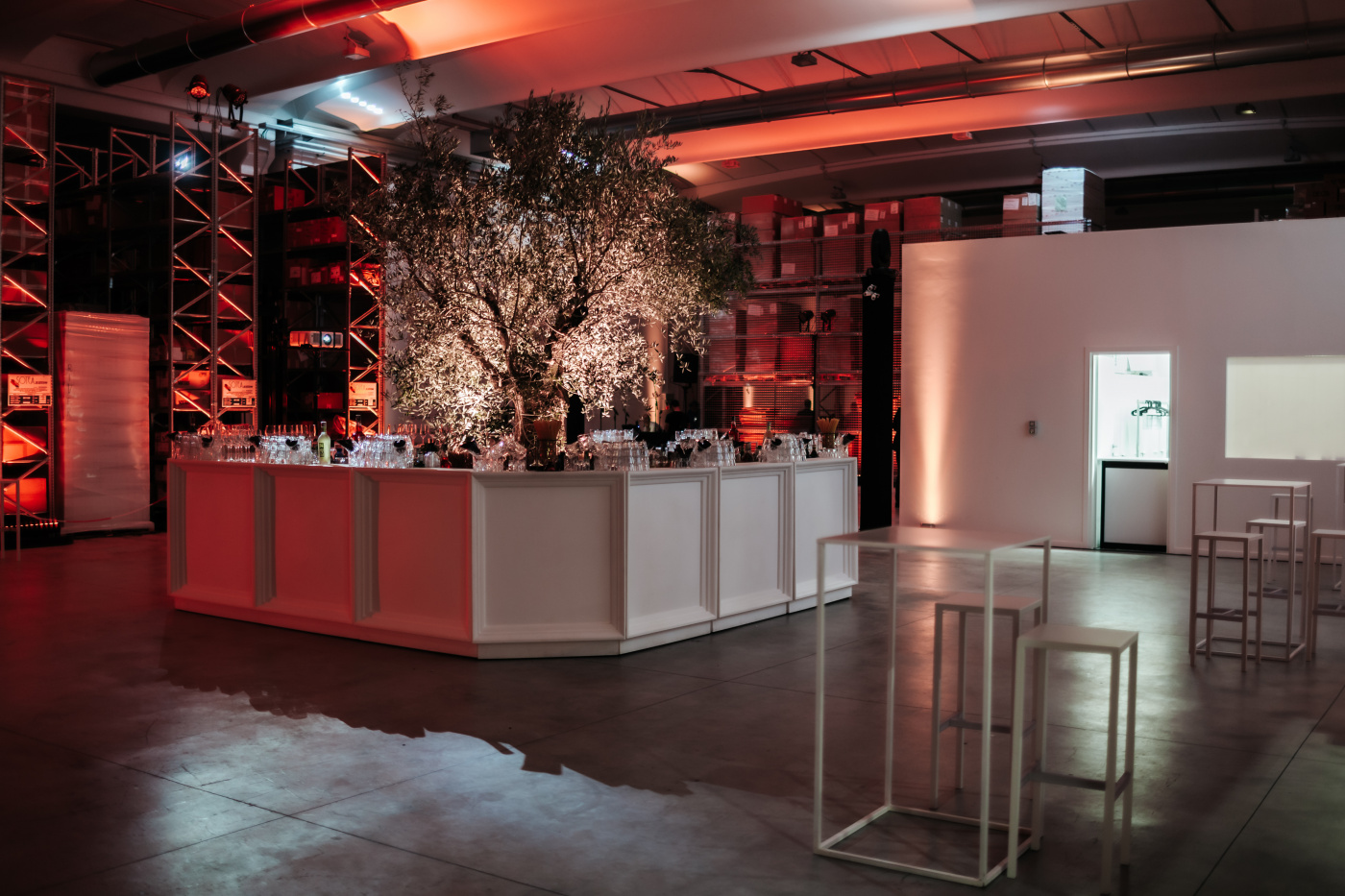 Event entrance with white bar station and olive tree