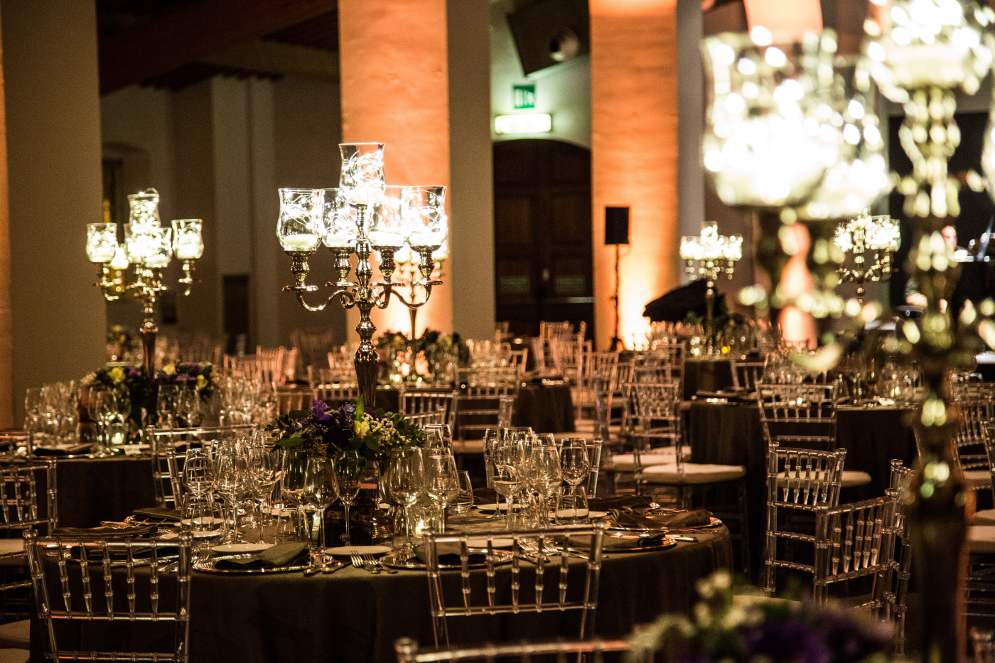 Corporate event for international bank with silver candelabras and round tables