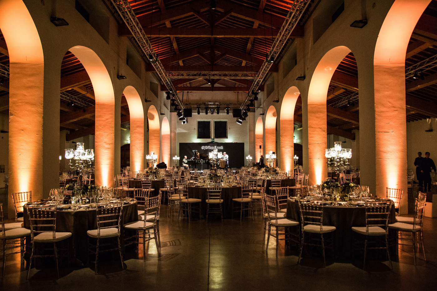 Corporate event in Florence with round tables and candelabras
