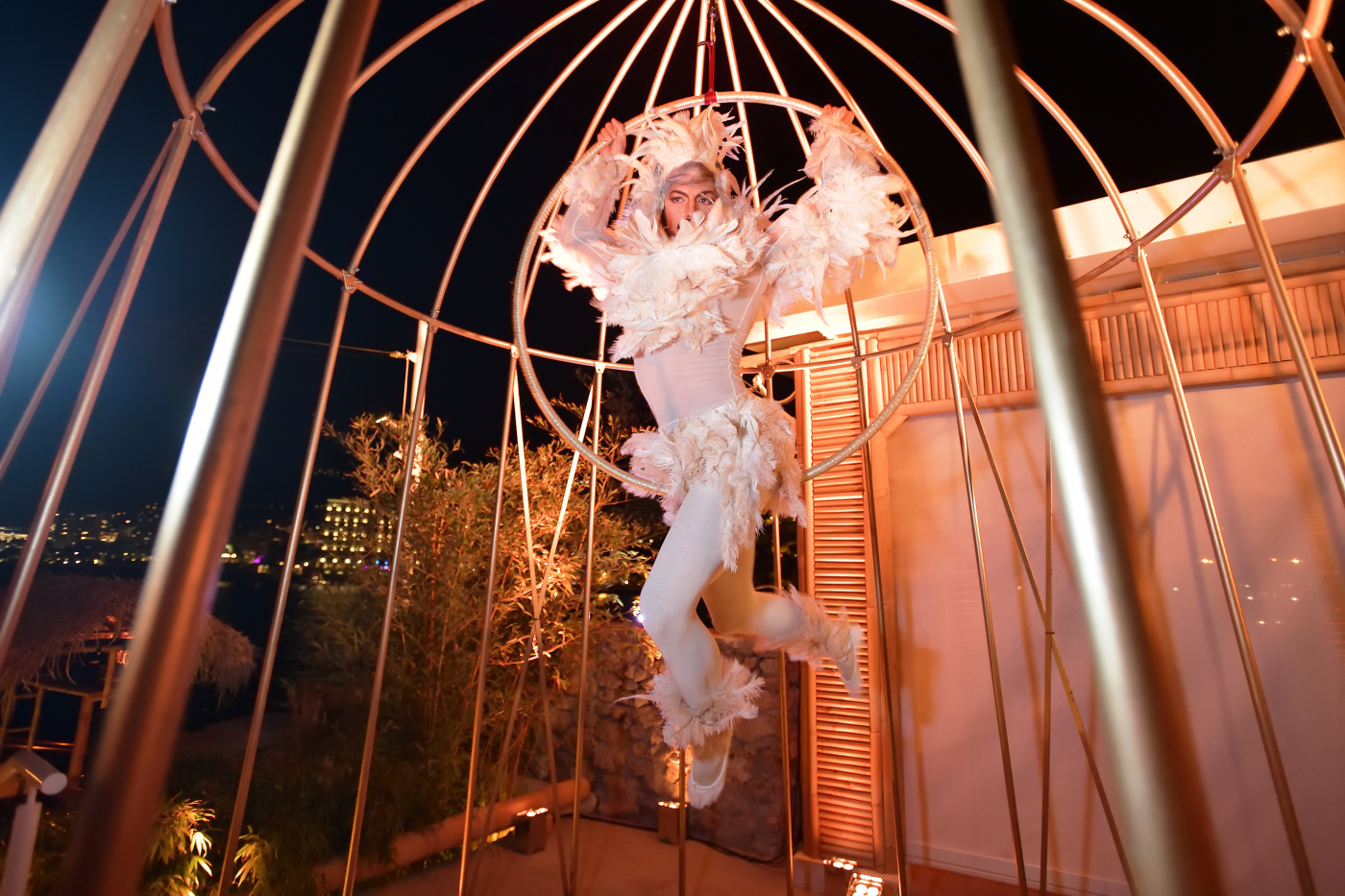 acrobat dancing in a golden cage as birthday entertainment