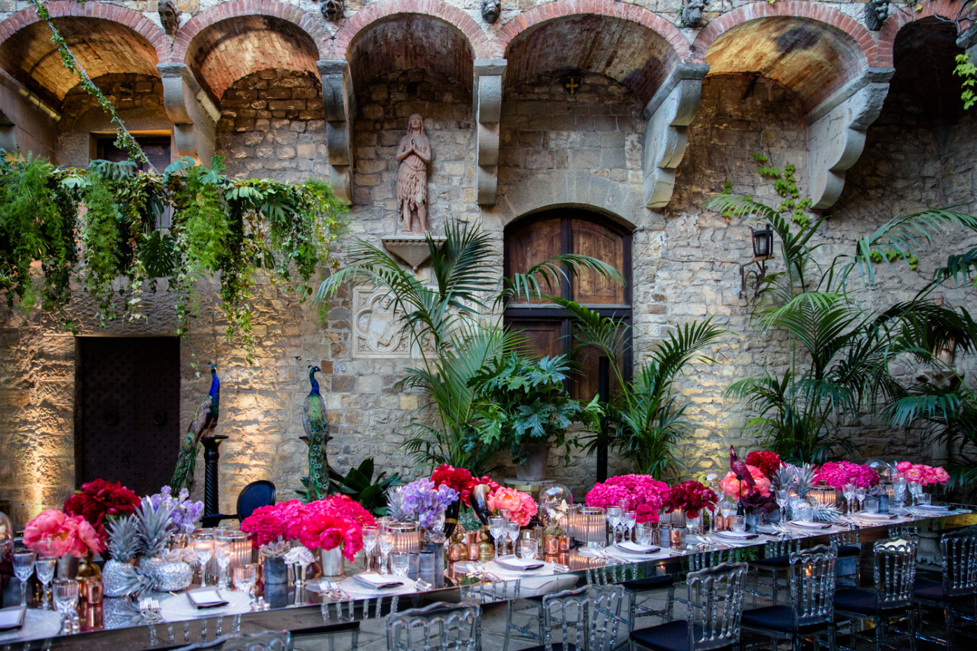 Long rectangular table with plants and flowers with red and fuxia