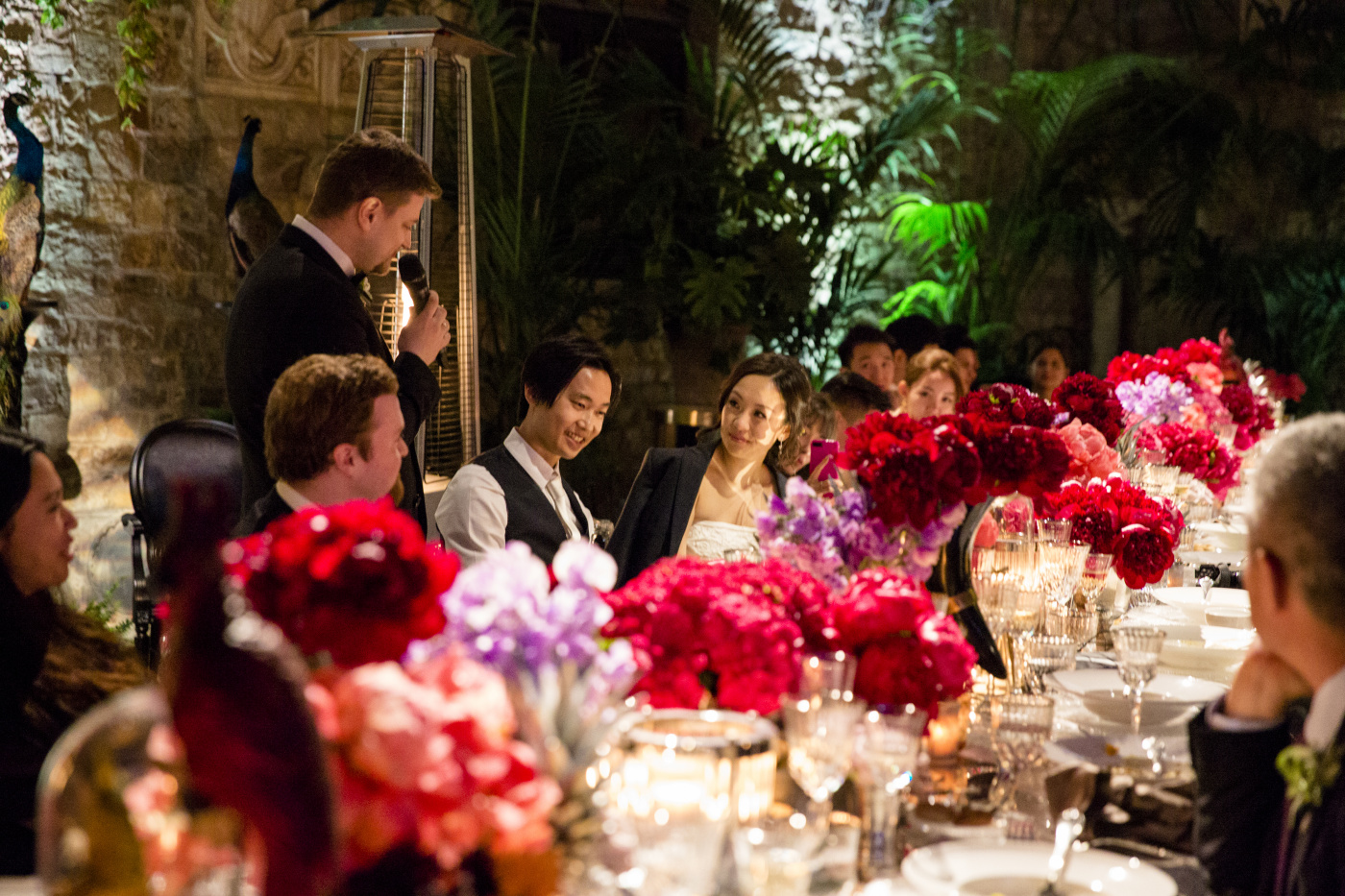 Wedding dinner with jungle themed flowers decor