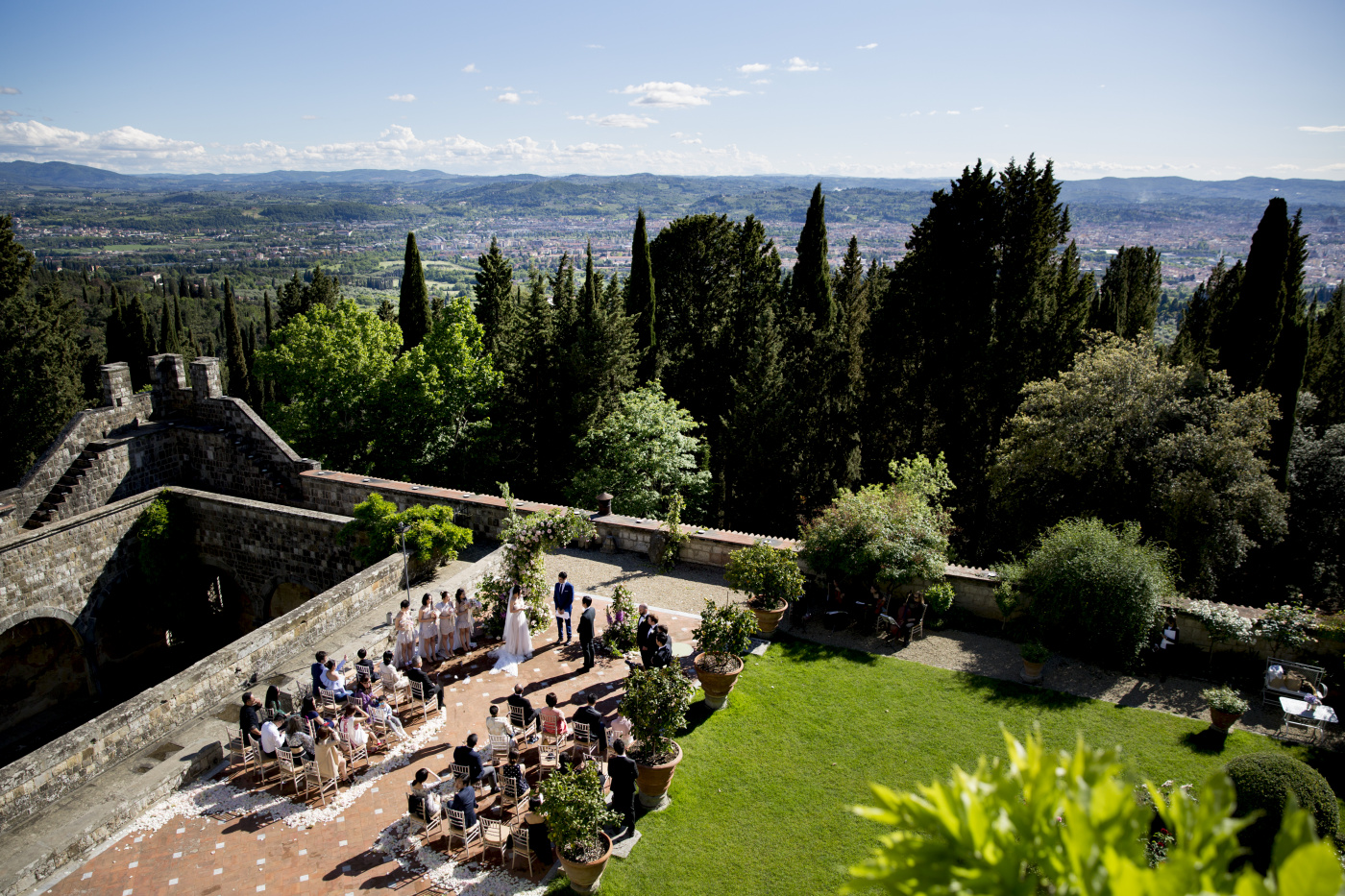 Outdoor ceremony in a garden with view