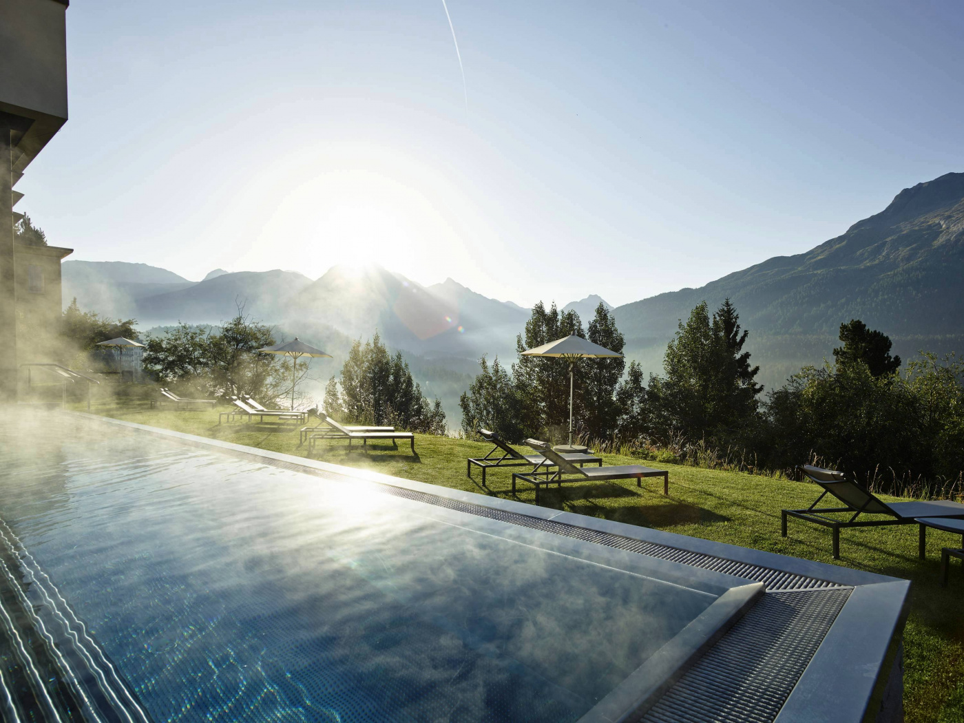 outdoor swimmingpool with summer view in saint moritz